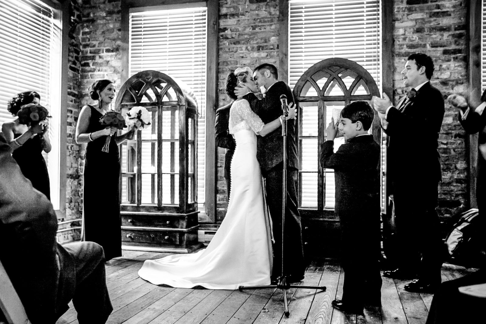 Wedding Kiss by Maggie Rife Ponce Photographer.